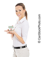 Businesswoman holding a model of house