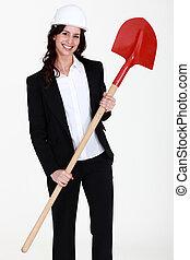 businesswoman holding a shovel