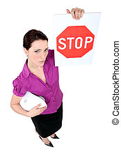 Businesswoman holding a stop sign