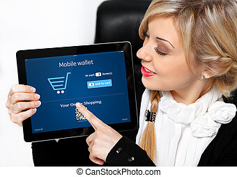 businesswoman holding a tablet with mobile wallet onlain...