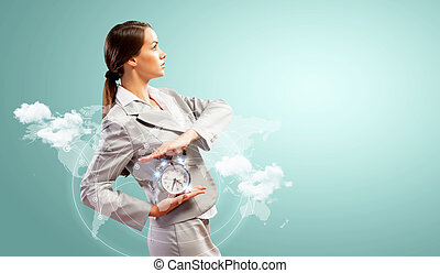 Businesswoman holding alarmclock - Image of young...