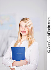 Businesswoman Holding Application Book In Office