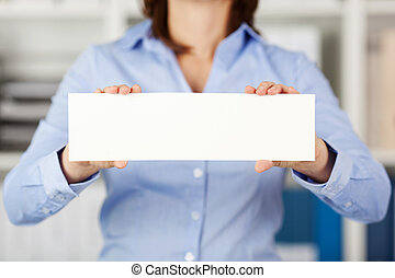 Businesswoman Holding Blank Paper In Office