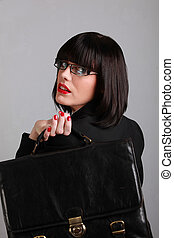 businesswoman holding briefcase over shoulder
