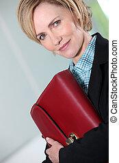 Businesswoman holding briefcase.
