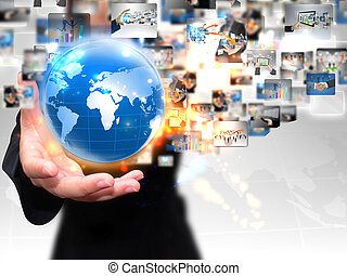 businesswoman holding business world