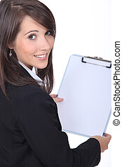 Businesswoman holding clipboard