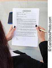 Businesswoman Holding Contract Papers