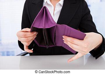 Businesswoman Holding Empty Wallet