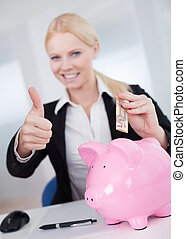 Businesswoman holding euro currency