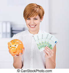 Businesswoman Holding Euro Notes And Piggybank