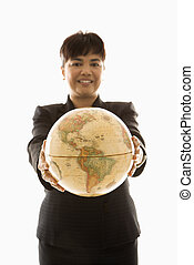 Businesswoman holding globe. - Filipino middle-aged ...