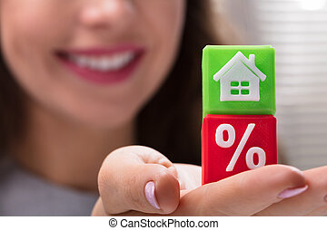 Businesswoman Holding Green And Red Cubic Blocks