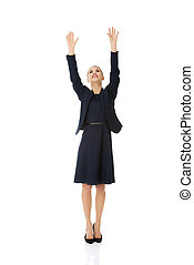 Businesswoman holding hands up