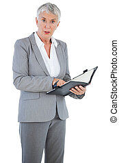 Businesswoman holding her diary