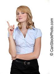 Businesswoman holding her finger up