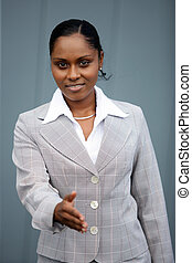 Businesswoman holding her hand out for a handshake
