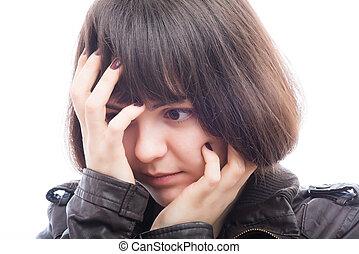 businesswoman holding her head in her hands