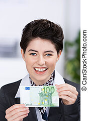 Businesswoman Holding Hundred Euros Banknote In Office