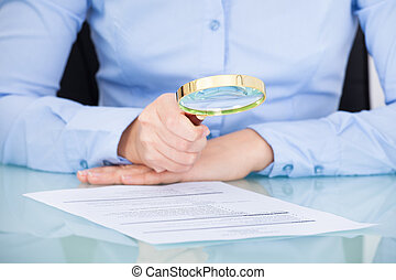 Businesswoman Holding Magnifying Glass - Businesswoman...