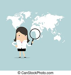 Businesswoman holding magnifying glass finding over world map.