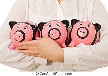 Businesswoman holding piggy-banks - Businesswoman holding...