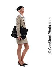 Businesswoman holding satchel