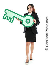 Businesswoman holding sign of key