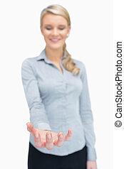 Businesswoman holding something