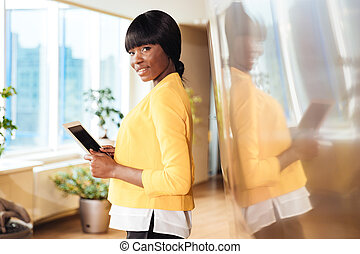 Businesswoman holding tablet computer in office