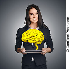 Businesswoman holding tablet with brain. Symbolizes fresh business ideas