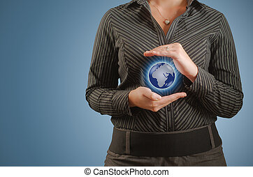 Businesswoman holds or holding world earth in hand