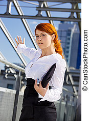 businesswoman in a front of a building site