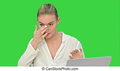 Businesswoman in a good mood dance, sitting on the desk with laptop, and answer a phone call on a Green Screen, Chroma Key.