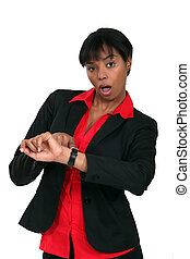 businesswoman in a hurry looking at her watch