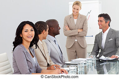 Businesswoman in a meeting with her team - Attractive...
