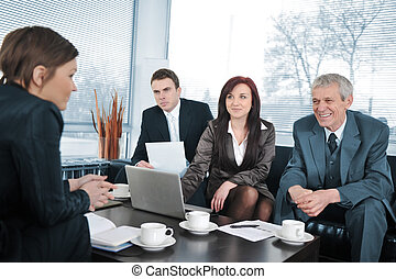 Businesswoman in an interview with three business people ...