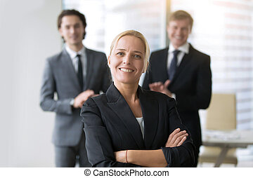 Businesswoman in center of group