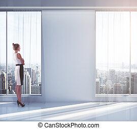 Businesswoman in empty room