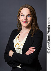 Businesswoman in front of a grey background