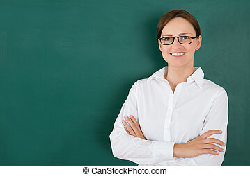 Businesswoman In Front Of Blackboard