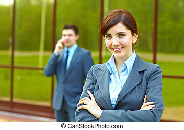 Businesswoman in front of building