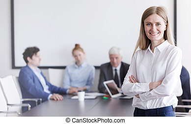 Businesswoman in front of her team