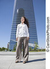 businesswoman in front of skyscrapers