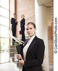 Businesswoman in front of two other women