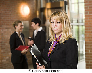 Businesswoman in front of two women