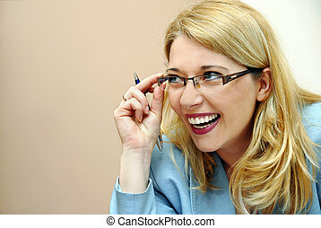 Businesswoman in glasses laughing