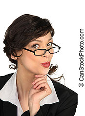 Businesswoman in glasses pouting cheekily