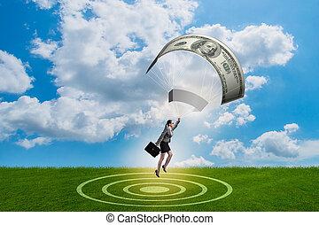 Businesswoman in golden parachute concept