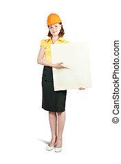 businesswoman in hardhat holding banner